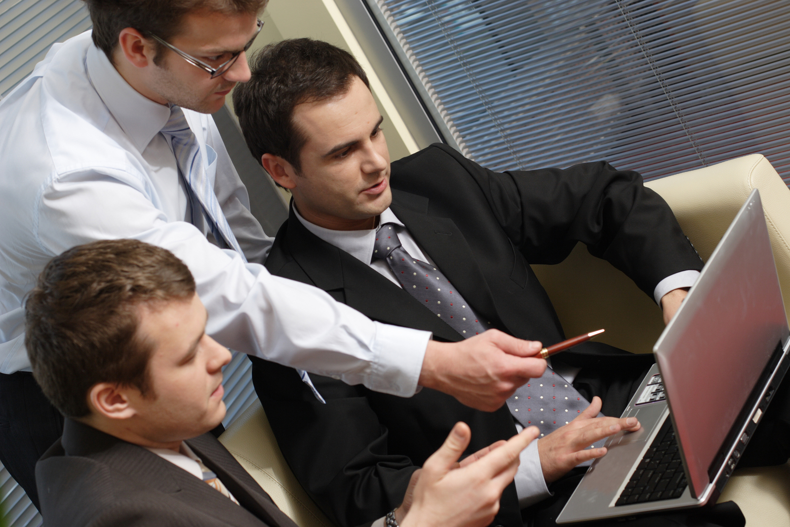 young-business-men-working-with-laptop
